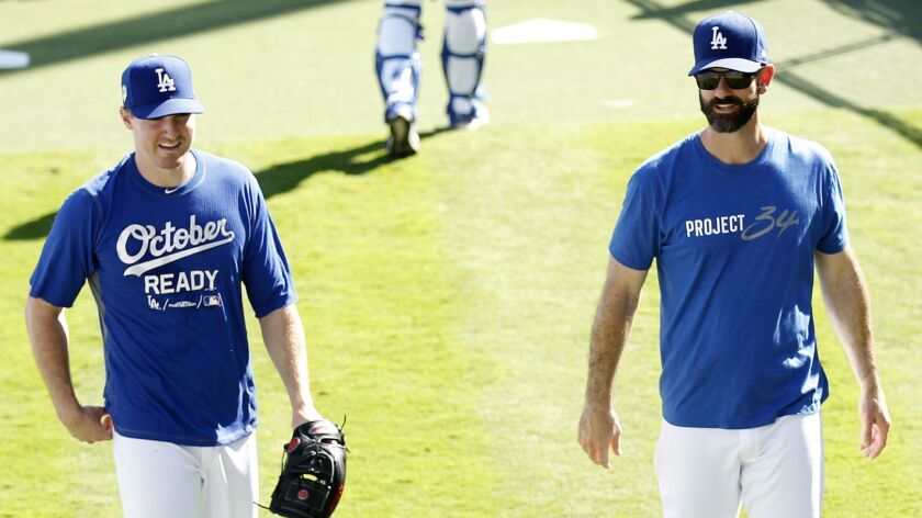 Dodgers bullpen coach Mark Prior, right, talks with pitcher Ross Stripling before Game 3 of the World Series at Dodger Stadium on Friday.