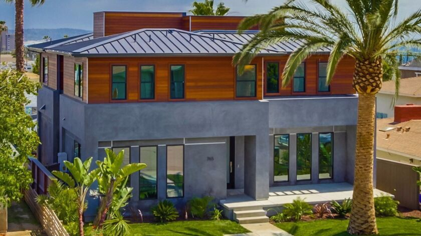 A North Pacific Beach home on the tour has a metal roof, mahogany siding and porcelain-like stucco.