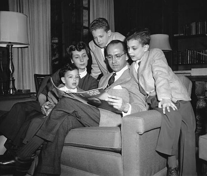 Dr. Jonas Salk reads Life magazine with his wife and three boys. From left are Jonathan, 5; Donna Salk; Peter, 11; Jonas Salk; and Darrell, 8.