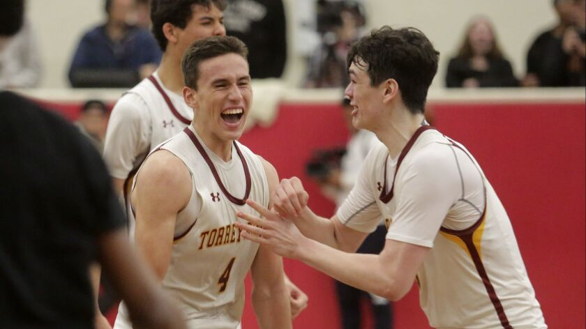 Torrey Pines' Bryce Pope (left) celebrates with teammate Noah Viera after beating Mission Bay on Wednesday during the San Diego Section Open Division semifinal game at Torrey Pines High.