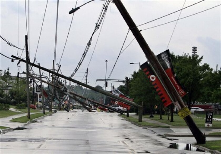 A row of electric power poles snapped along Floyd Street at Central Avenue in front of Cardinal Stadium at the University of Louisville in Louisville, Ky., Wednesday, June 22, 2011 after an apparent tornado moved through the area. At least five barns were damaged and horses were running loose Wednesday at Churchill Downs, home of the Kentucky Derby, after a powerful storm that spawned tornadoes blew through Louisville. (AP Photo/Garry Jones)