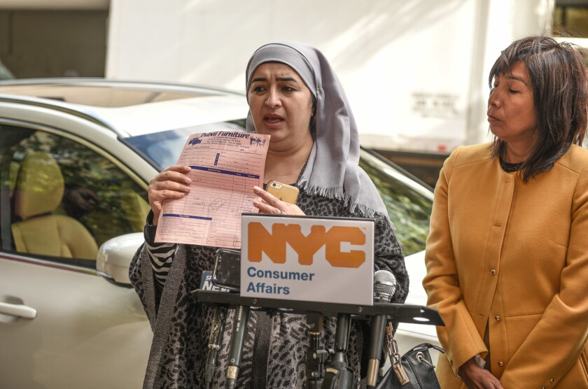 Breshna Noori speaks during a press conference Wednesday morning. She claims she was ripped off by Queens furniture store, Dubai Furniture, which is owned by Maddy's Home Furniture.
