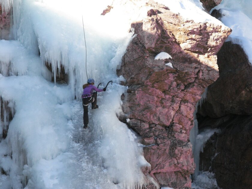 This Jan. 18, 2014 photo shows an unidentified climber making her way up the Ouray Ice Park in Ouray, Colo. Chicks with Picks, a company founded to introduce the sport of ice climbing to women, holds several clinics each winter in in the Ouray Ice Park,  a city-owned facility with man-made ice in a