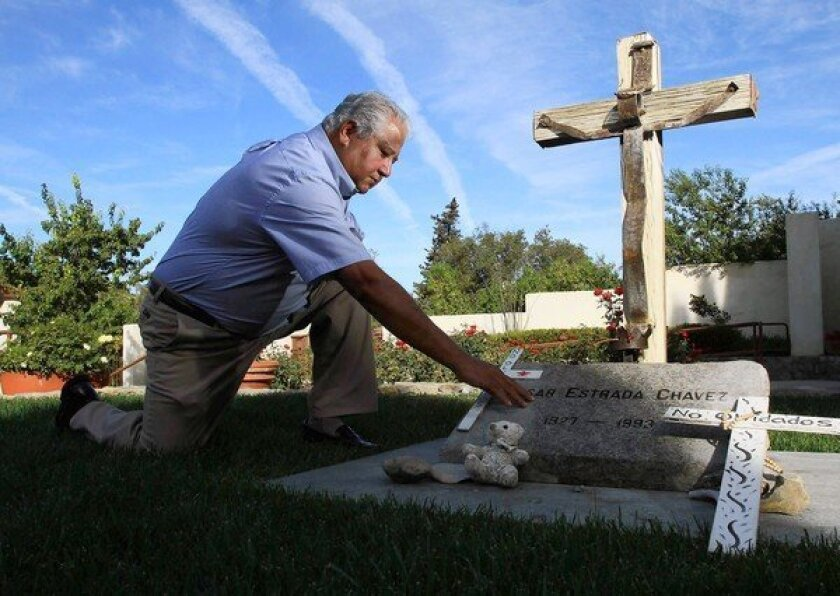 Paul Chavez, son of the late labor leader Cesar Chavez, at his father's grave in Keene, Calif., in October 2012. (Irfan Khan / Los Angeles Times)