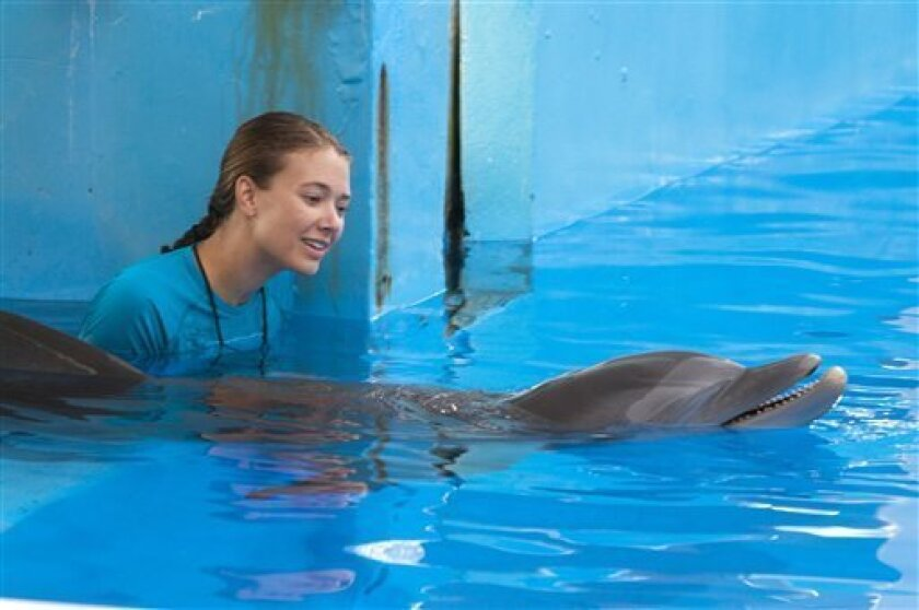"""Austin Highsmith is seen here in the role of Phoebe in Alcon Entertainment's family adventure, """"Dolphin Tale"""", in the Warner Bros. Pictures release. """"Dolphin Tale"""" dethroned """"The Lion King"""" in the weekend box office. The """"Dolphin Tale"""" held up well with $14.2 million in it's second weekend to take the #1 spot from the """"Lion King"""", the Disney reissue that had been at the top of the past two weekends. (AP Photo/Jon Farmer, Alcon Entertainment)"""