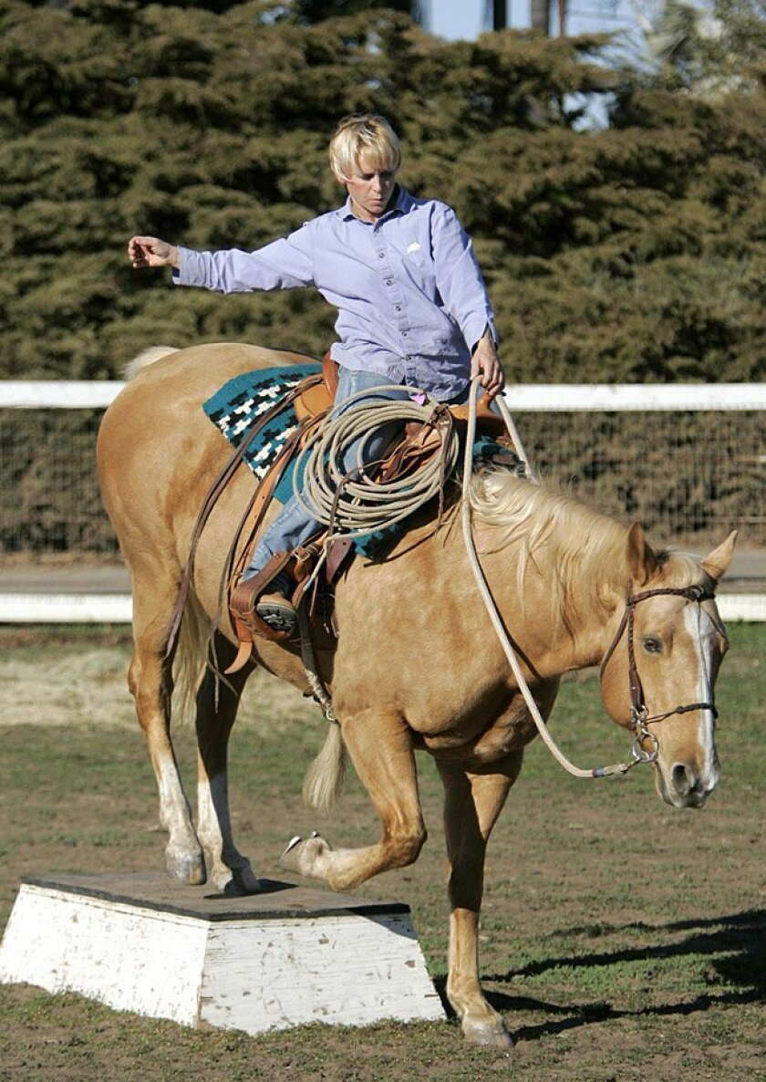 Julie Krone rode her horse, Miss Piggy, on Tuesday at the Osuna Valley Stock Farm. The former jockey is the only woman in the Thoroughbred Racing Hall of Fame.
