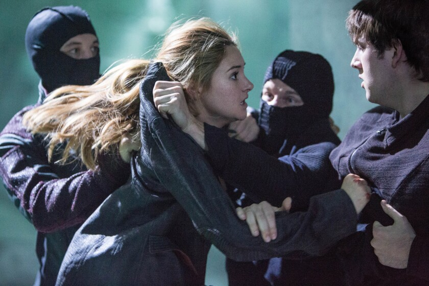 SHAILENE WOODLEY and CHRISTIAN MADSEN star in the movie DIVERGENT