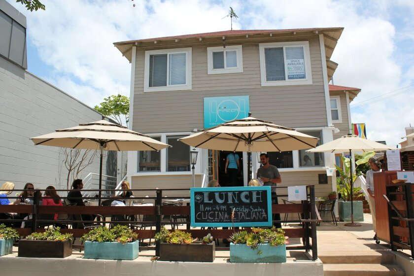 """Piazza 1909 restaurant has opened at 7731 Fay Ave., in one of La Jolla's original beach cottages, named """"The Brodiaea,"""" built in 1909 (former site of Aloha Sushi Lounge)."""