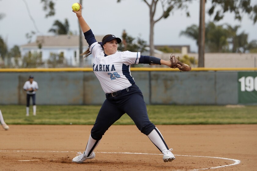 Marina High starter Emily Rush throws against Edison during the first inning in a Surf League game a