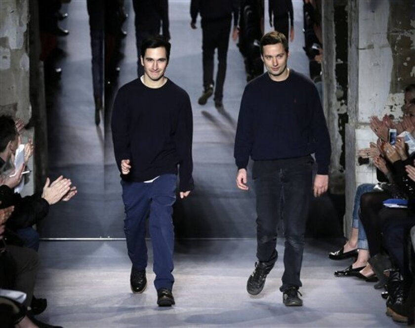 FILE - This Feb. 13, 2013 file photo shows designers Jack McCollough, right, and Lazaro Hernandez after the Proenza Schouler Fall 2013 collection is shown during Fashion Week in New York. Alexander Wang and Proenza Schouler are among the leading nominees for this year's Council of Fashion Designers