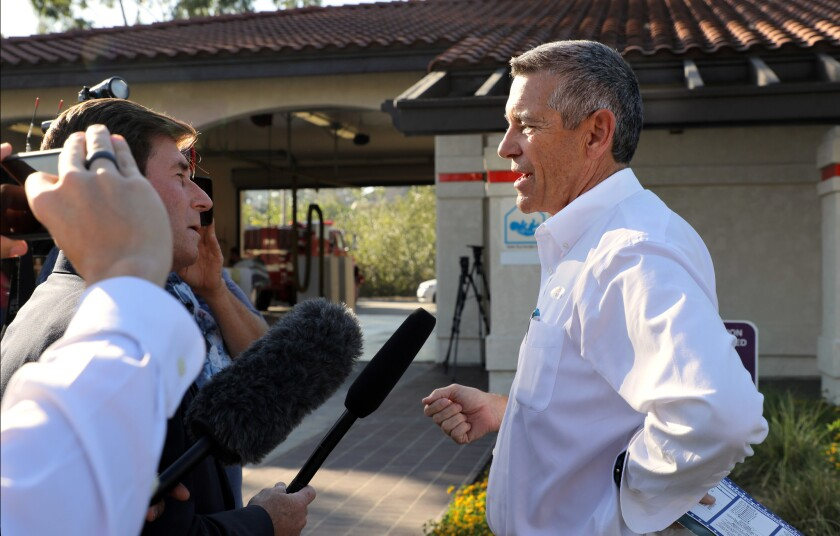 House candidate Doug Applegate speaks to members of the media in front of the Carlsbad Fire Station on election day.