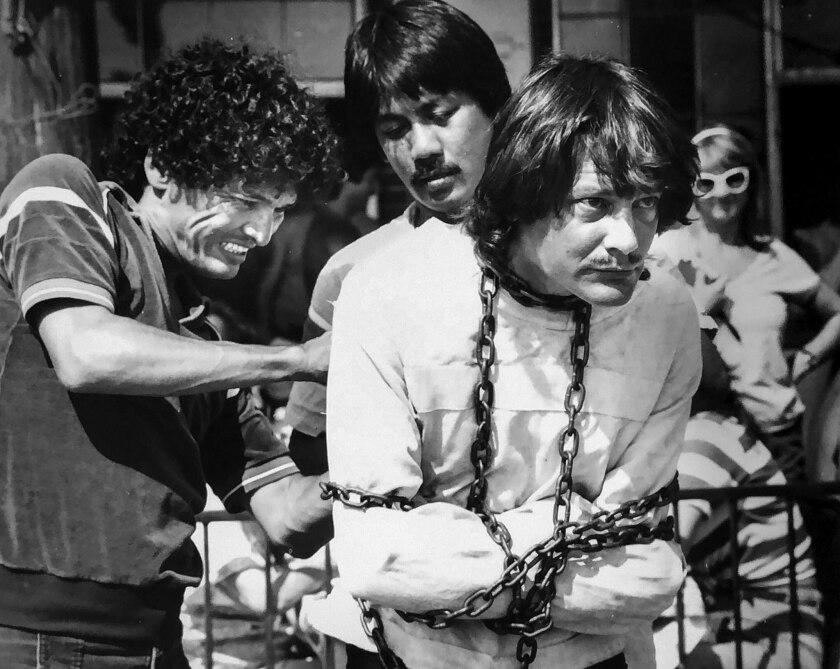 July 1984: Escape artist Tim Eric is placed in chains and straitjacket at Venice Beach.