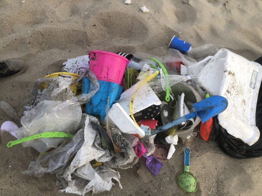 A pile of trash on the sand