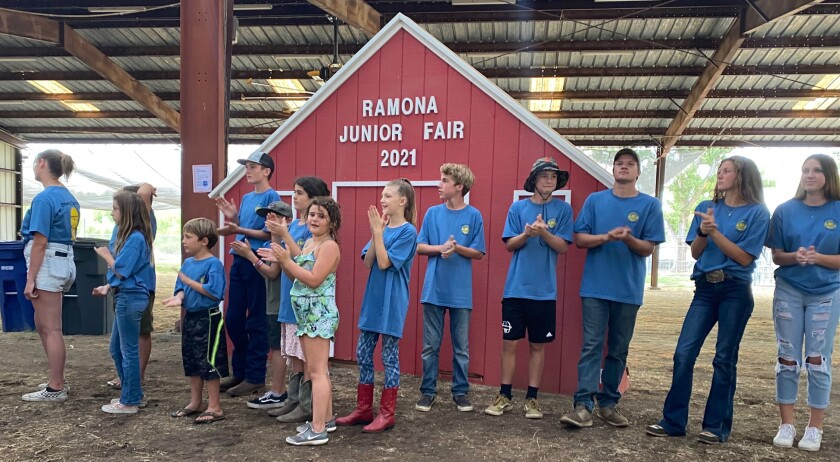 Members of 4-H, FFA and Grange clubs wait their turn to show off the desserts at the Ramona Junior Fair Pie Auction.