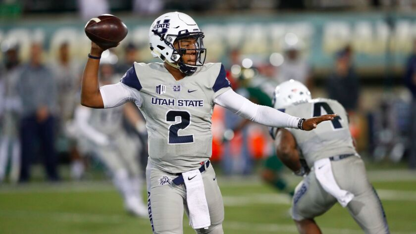 Utah State quarterback Kent Myers is a threat running the ball as well as passing it for the Aggies.