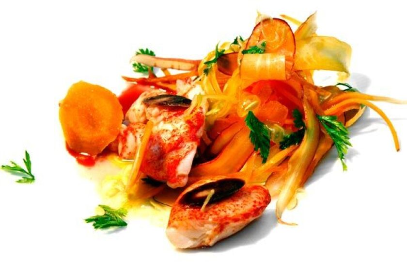 Butter-poached lobster is paired with carrots.