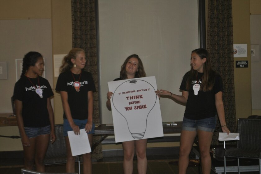 VACHI founder Megan Micheletti (center) encourages students to turn on their mental 'light bulbs' before they say cruel things to others. Photos by Liz Schneider