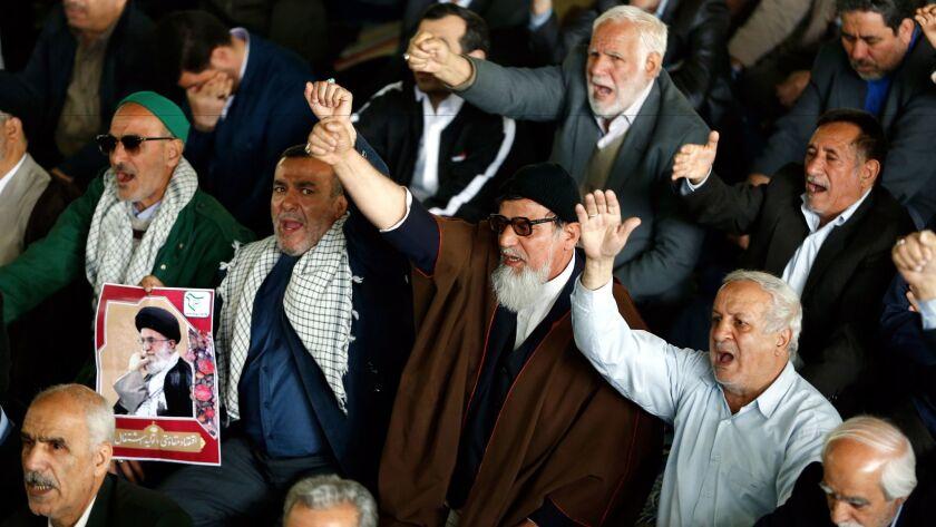 epa05894073 Iranians shout anti-US slogans after the Friday prayer ceremony in Tehran, Iran, 07 Apri