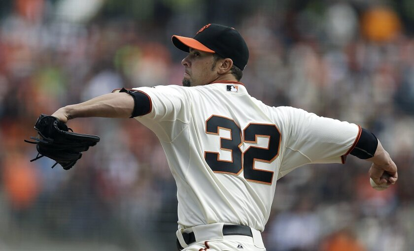 San Francisco Giants' Ryan Vogelsong works against the Cleveland Indians in the first inning of a baseball game, Sunday, April 27, 2014, in San Francisco. (AP Photo/Ben Margot)