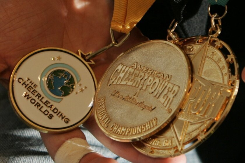 Medals are at stake in competitive cheerleading.
