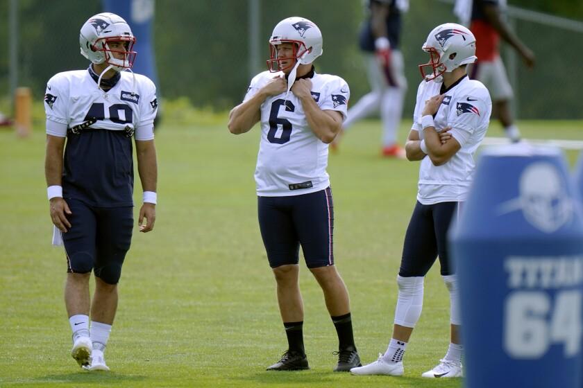 New England Patriots Long snapper Joe Cardona (49) kicker Nick Folk (6) and punter Jake Bailey, right, confer during an NFL football training camp practice, Tuesday, Aug. 25, 2020, in Foxborough, Mass. (AP Photo/Steven Senne, Pool)