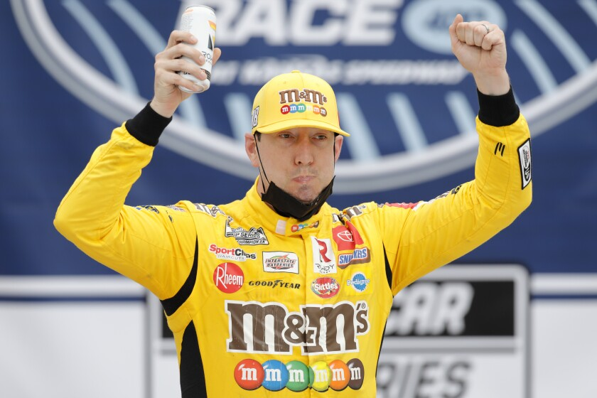 Kyle Busch celebrates in victory lane after winning Sunday's NASCAR Cup race at Kansas Speedway.