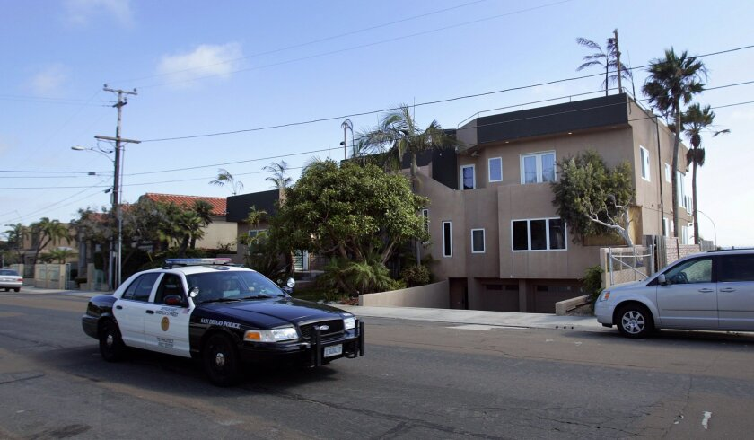 """A police officer patrols near the home where MTV's """"The Real World"""" is being filmed in Bird Rock."""