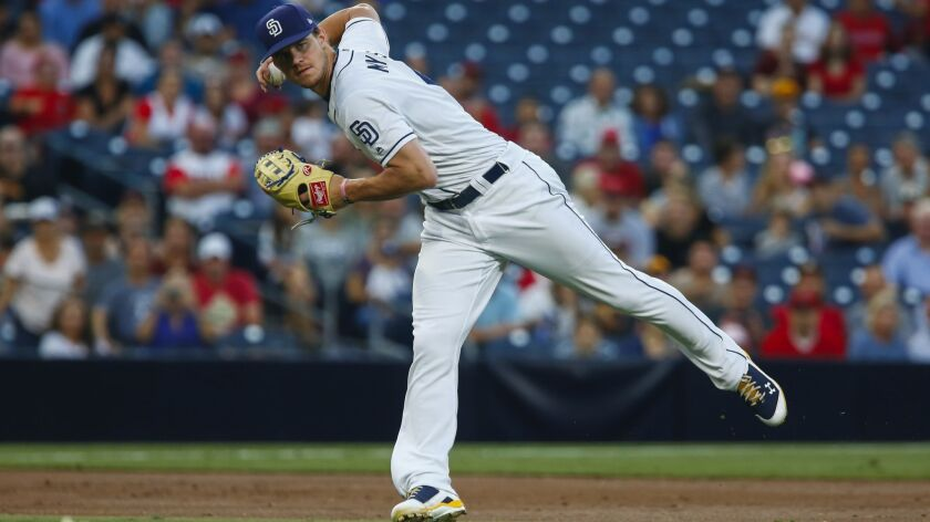 San Diego Padres third baseman Wil Myers (4) throws to first on a grounder from Los Angeles Angels left fielder Justin Upton (8) in the first inning.