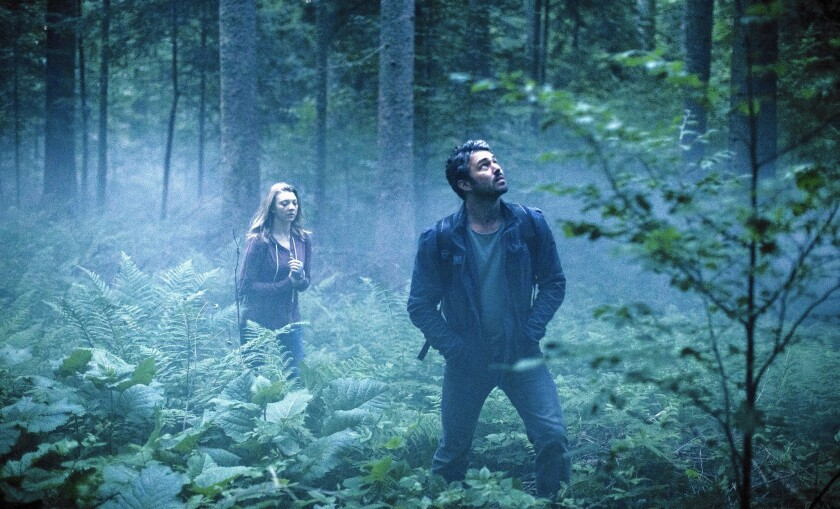 "Natalie Dormer and Taylor Kinney in ""The Forest."""