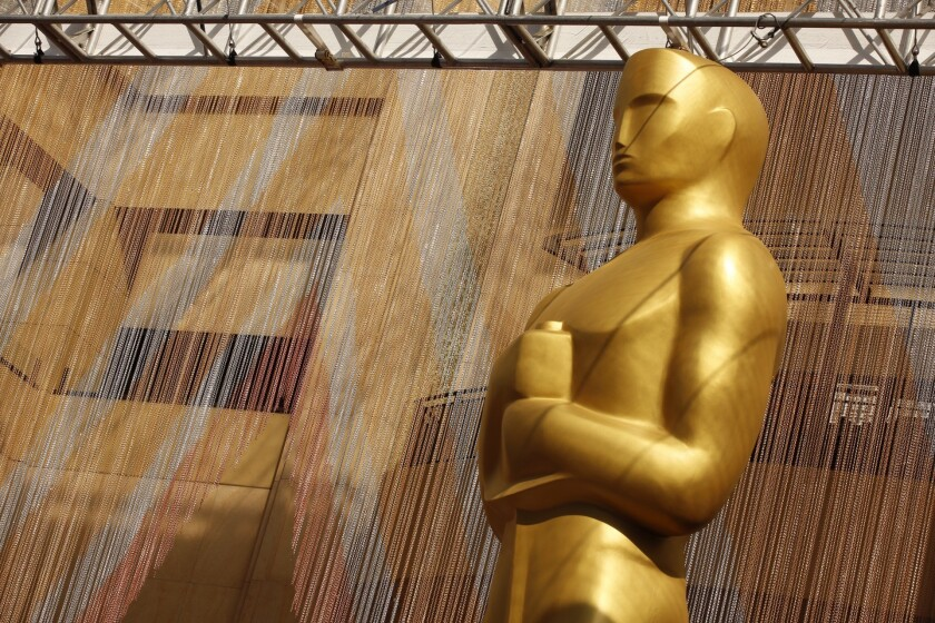 A colorful chain curtain is the backdrop for a giant Oscar statue at Hollywood and Highland on the red carpet Friday, Feb. 26, 2016, as preparations continue for this Sunday's 88th Academy Awards.