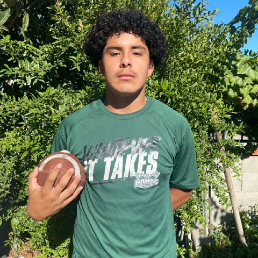 Daniel Longoria holds a football.