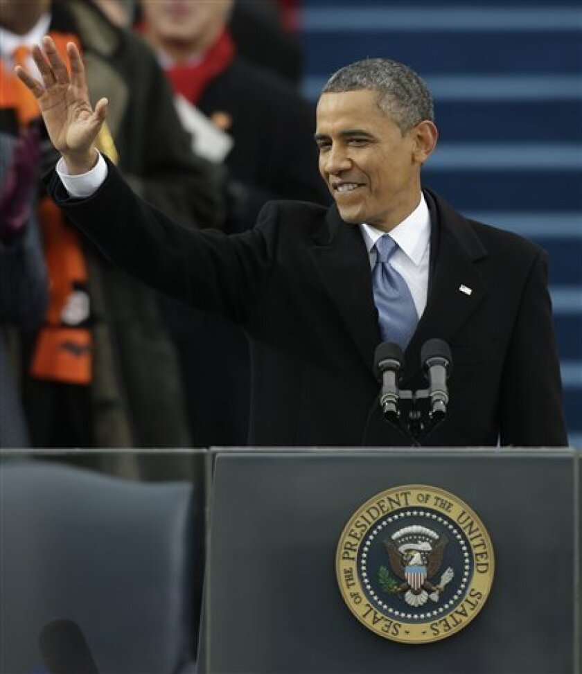 President Barack Obama waves after his ceremonial swearing-in at the U.S. Capitol during the 57th Presidential Inauguration in Washington, Monday, Jan. 21, 2013.