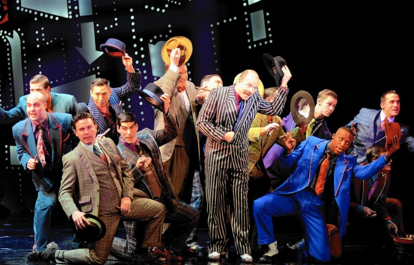 "Christopher Swan, as Nathan Detroit ,and the cast of the national tour of ""Guys and Dolls,"" which is at the Segerstrom Center for the Arts through Sunday."