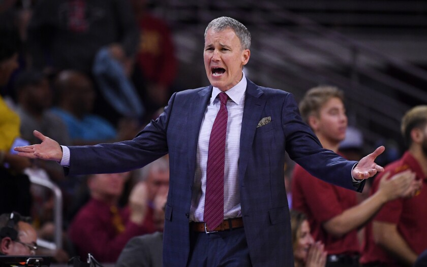 USC coach Andy Enfield argues with a referee during a win over Washington on Feb. 13.