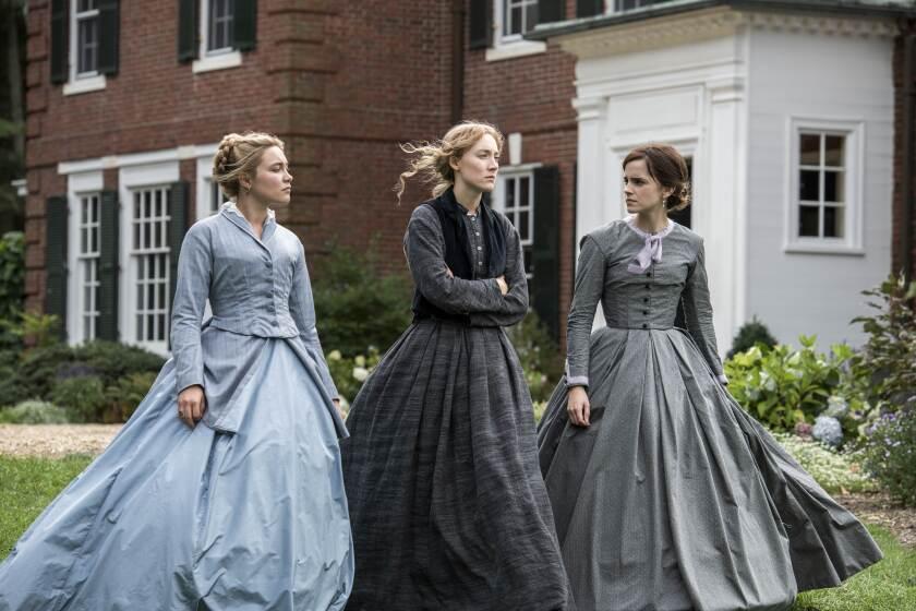 "Florence Pugh, left, Saoirse Ronan and Emma Watson in ""Little Women."""
