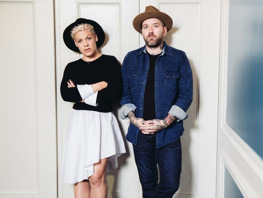 """In this Friday, Oct. 10, 2014 photo, folk music duo You+Me, consisting of Alecia Moore, left, known as Pink, and Dallas Green pose for a portrait during an interview at The Viceroy Hotel in Santa Monica, Calif.  Their debut album, """"rose ave.,"""" releases Tuesday, Oct. 14, 2014. It's a collection of n"""
