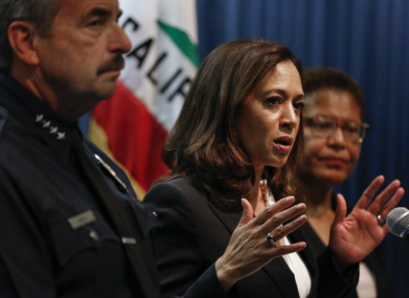 Kamala Harris, then California attorney general, appears alongside Rep. Karen Bass, right, at a news conference.