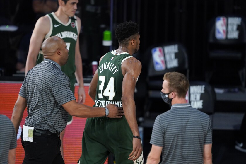 Milwaukee Bucks' Giannis Antetokounmpo (34) heads to the locker room after being ejected during the first half of an NBA basketball game against the Washington Wizards, Tuesday, Aug. 11, 2020, in Lake Buena Vista, Fla. (AP Photo/Ashley Landis, Pool)