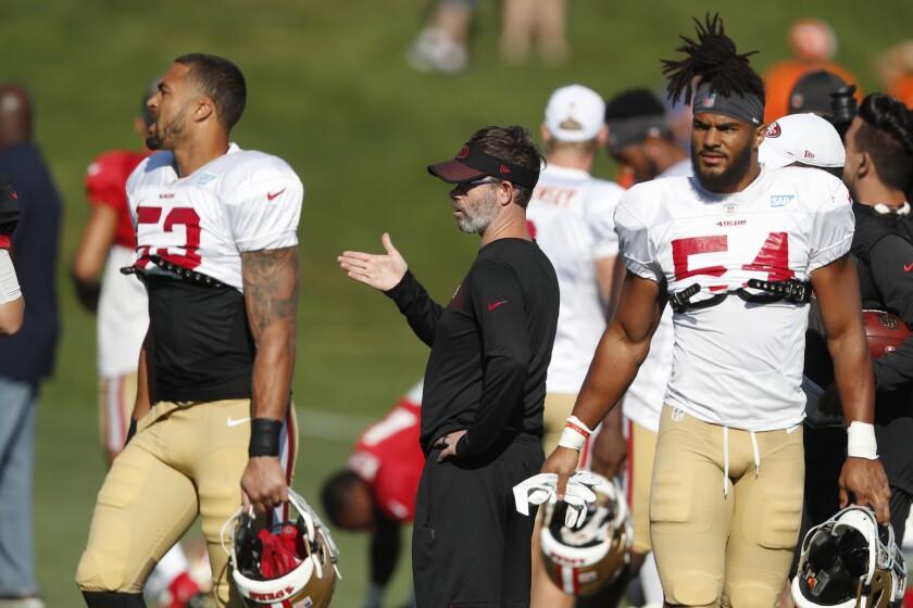 Former 49ers quarterback coach Shane Daye gives instructions.