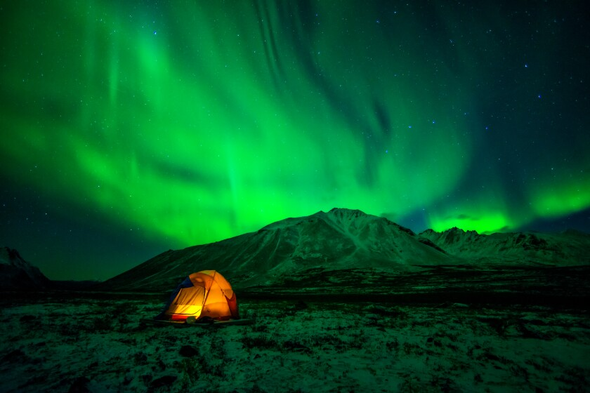 "A tent with the aurora borealis ""flaming coldly overhead,"" as mentioned by author Jack London"