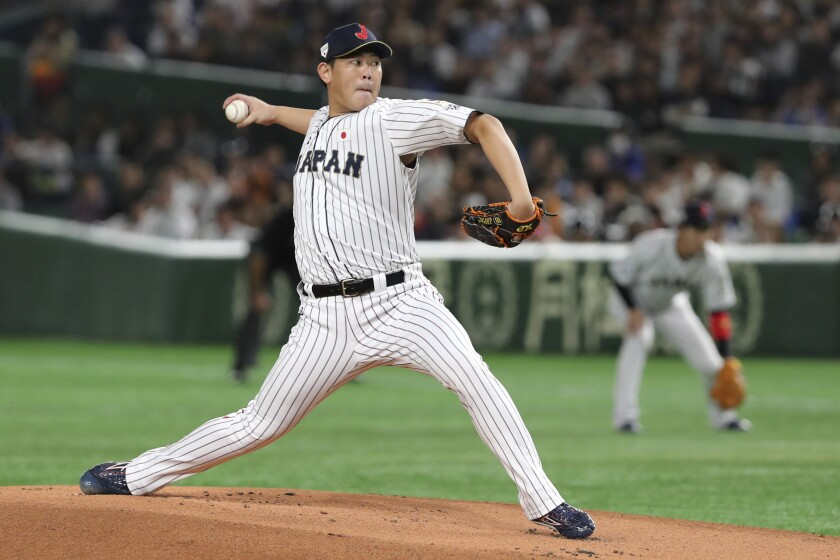FILE - In this Nov. 17, 2019, file photo, Japan starting pitcher Shun Yamaguchi delivers a pitch against South Korea in the first inning of their Premier12 baseball tournament final game at Tokyo Dome in Tokyo. Yomiuri Giants right-hander Shun Yamaguchi and Hiroshima Toyo Carp second baseman Ryosuke Kikuchi have been made available to major league teams through the posting process. Major league clubs have until 5 p.m. EST on Jan. 2 to negotiate with the pair, Major League Baseball said Tuesday, Dec. 3, 2019. (AP Photo/Toru Takahashi, File)