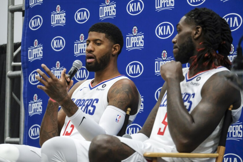 Clippers forward Paul George answers a reporter's question during media day on Sunday.