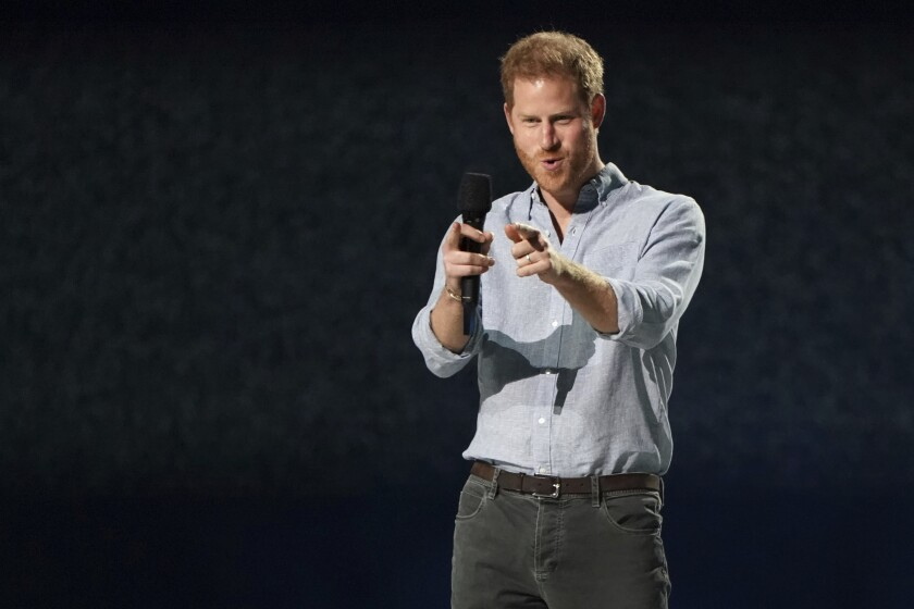 A smiling Prince Harry speaks at 'Vax Live'