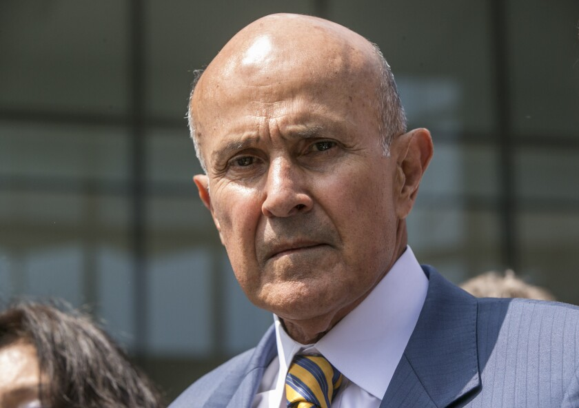 FILE - In this May 12, 2017, file photo, former Los Angeles County Sheriff Lee Baca leaves federal court in Los Angeles after he was sentenced to three years in prison for obstructing an FBI investigation into abuses at the jails he ran. Baca is likely headed to prison after the U.S. Supreme Court on Monday, Jan. 13, 2020, declined to review his corruption case, a newspaper reported. The 9th U.S. Circuit Court of Appeals last year rejected Baca's request to reconsider an earlier ruling upholding his conviction and three-year prison sentence. The lower court previously ruled that Baca received a fair trial. (AP Photo/Damian Dovarganes, File)