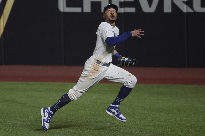 Dodgers right fielder Mookie Betts chases a fly ball during the NLCS against the Atlanta Braves.