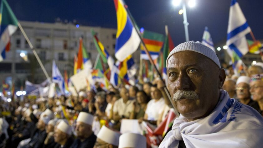 Israelis from the Druze community participate in a rally against Israel's Jewish Nation bill in Tel
