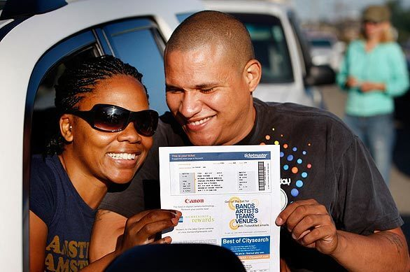 Fans collect their tickets to Michael Jackson memorial