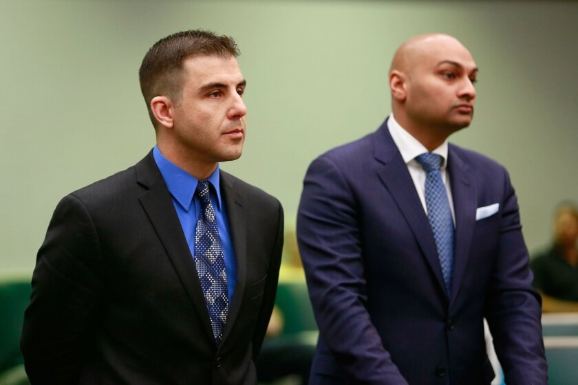 Former Carlsbad school district employee Daniel Czypinski, left, and defense attorney Vik Monder appear before a judge for Czypinski's arraignment hearing in Vista on Wednesday. Authorities accuse Czypinski of repeatedly renting out a school performing arts center but pocketing the money, nearly $149,000.