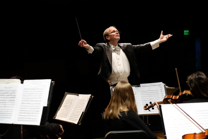 San Diego Youth Symphony Music Director Jeff Edmons is shown conducting in 2018.
