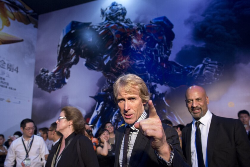 """A Benghazi drama directed by Michael Bay -- pictured at the 2014 Beijing opening of """"Transformers: Age of Extinction"""" -- is set to open over the Martin Luther King Jr. holiday next year."""